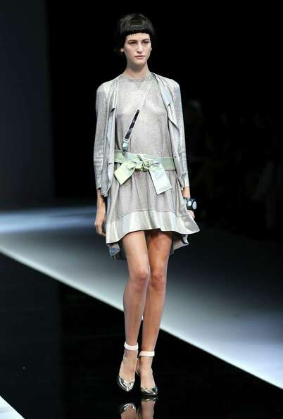 A model wears a creation as part of the Emporio Armani collection.
