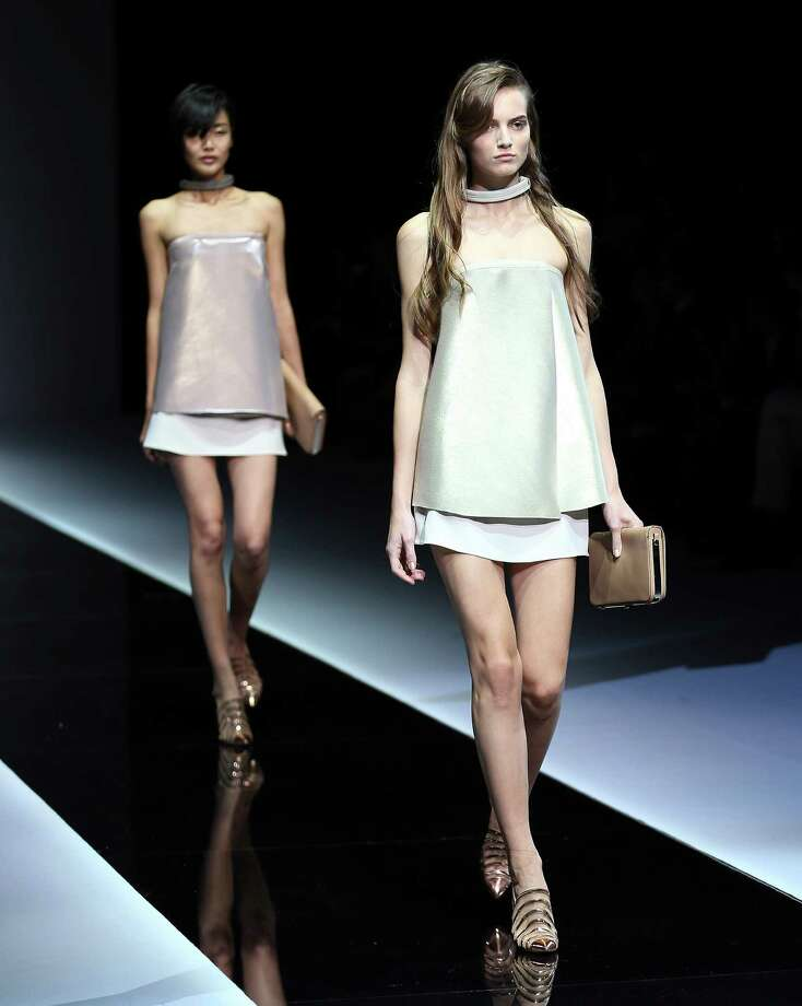 Models wear creations as part of the Emporio Armani collection. Photo: Antonio Calanni, ASSOCIATED PRESS / AP2012