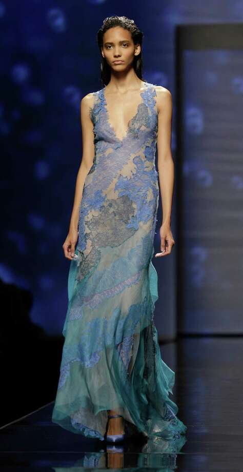 A model wears a creation as part of the Alberta Ferretti collection. Photo: Luca Bruno, AP / AP