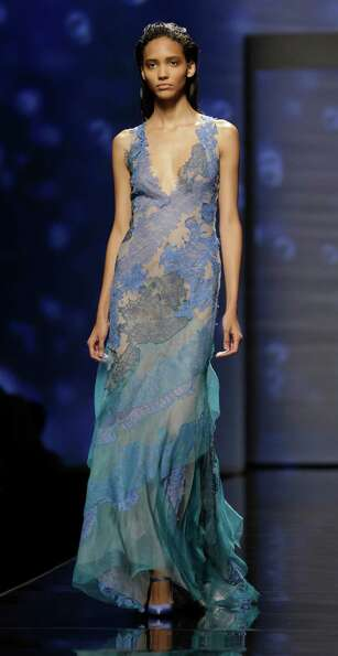 A model wears a creation as part of the Alberta Ferretti collection.