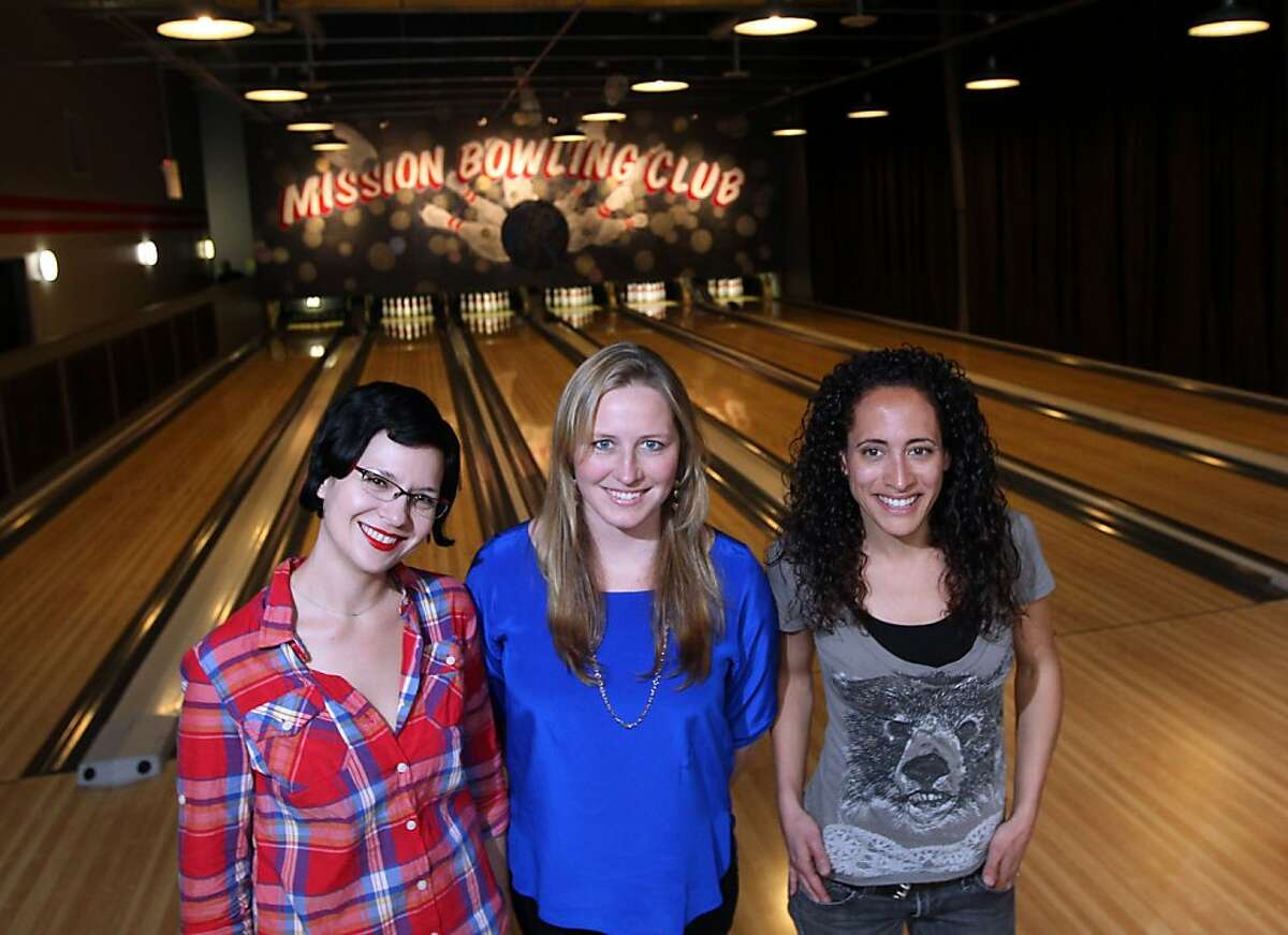 Danae Ringelmann co-founder of Indiegogo center stands with co-owners of the Mission Bowling Club Sommer Peterson left and Molly Bradshaw right, who relied in part on funding for their bossiness from Indiegogo an Internet company that helps raise funds for small businesses like Mission Bowling Club on 17th street in San Francisco California, Friday September 21, 2012.