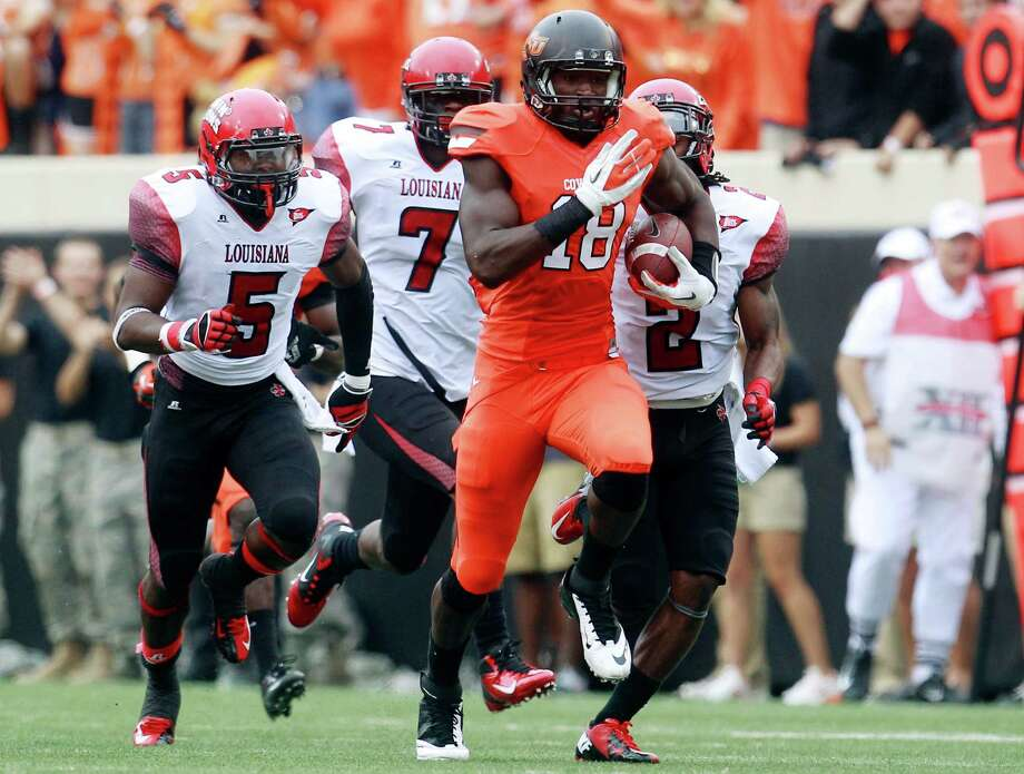 Oklahoma State tight end Blake Jackson carries against Louisiana-Lafayette in the second quarter of an NCAA college football game in Stillwater, Okla., Saturday, Sept. 15, 2012. Oklahoma State won 65-24. (AP Photo/Sue Ogrocki) Photo: Sue Ogrocki / AP