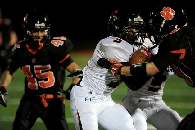 Cameron Webb carries the ball for Stamford during Friday's football game at Ridgefield High School on September 28, 2012. Photo: Lindsay Niegelberg / Stamford Advocate