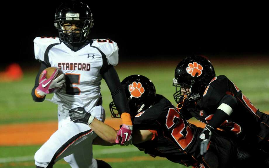 Stamford's Cameron Webb carries the ball during Friday's football game at Ridgefield High School on September 28, 2012. Photo: Lindsay Niegelberg / Stamford Advocate