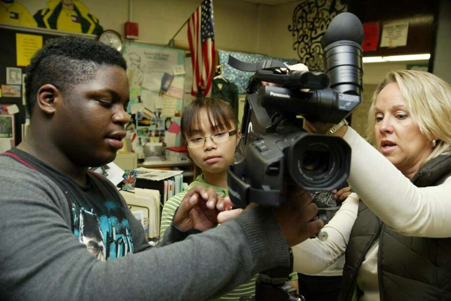 Bassick High School, (L-R) video students Byron Burton and Janet Chin set up a camera in class with instructor Kathy Silver. Silver's video students are finalists in a national contest sponsored by State Farm. Weds. De. 9, 2009. Photo: Phil Noel / Connecticut Post
