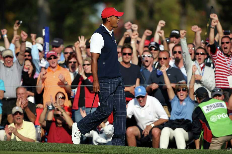 Tiger Woods of the USA celebrates winning the 11th hole during the Afternoon Four-Ball Matches for The 39th Ryder Cup at Medinah Country Club on September 28, 2012 in Medinah, Illinois. Photo: Ross Kinnaird / 2012 Getty Images