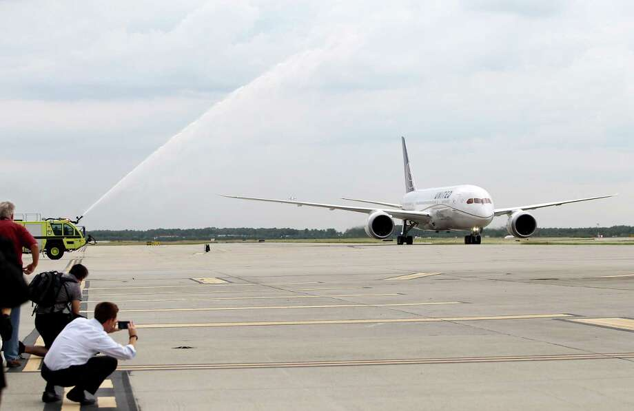 United's first Boeing 787 Dreamliner gets sprayed with water from fire engines as it touches down at Bush Intercontinental Airport, Friday, Sept. 28, 2012, in Houston. Photo: Karen Warren, Houston Chronicle / © 2012  Houston Chronicle