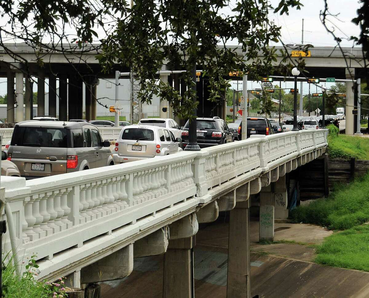 City officials lowered the weight limit of the Yale Street bridge at the direction of the Texas Department of Transportation. One local group has called for the bridge to be closed immediately to ensure safety.
