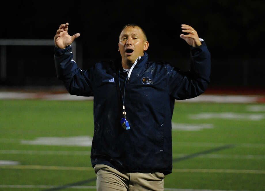 Weston Head Coach Joe Lato, during football action against Pomperaug in Southbury, Conn. on Friday September 28, 2012. Photo: Christian Abraham / Connecticut Post