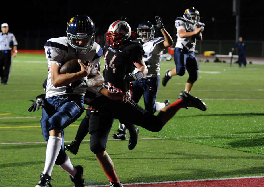 Weston's #4 Erik Dammen-Brower crosses into the endzone for a touchdown, during football action against Pomperaug in Southbury, Conn. on Friday September 28, 2012. Photo: Christian Abraham / Connecticut Post