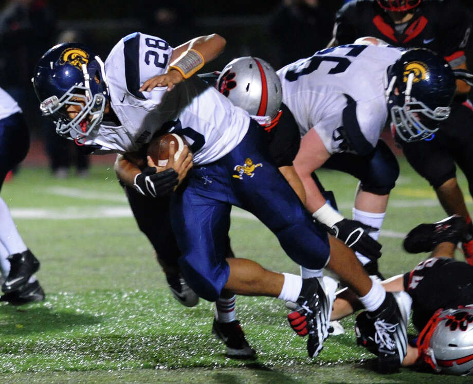 Football action between Pomperaug and Weston in Southbury, Conn. on Friday September 28, 2012. Photo: Christian Abraham / Connecticut Post