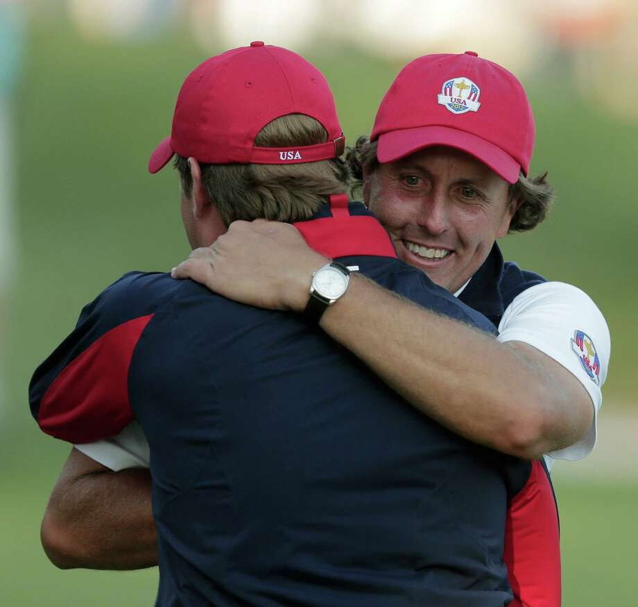 USA's captain Davis Love III hugs Phil Mickelson on the 17th hole after winning a four-ball match at the Ryder Cup PGA golf tournament Friday, Sept. 28, 2012, at the Medinah Country Club in Medinah, Ill. (AP Photo/Charlie Riedel) Photo: Charlie Riedel