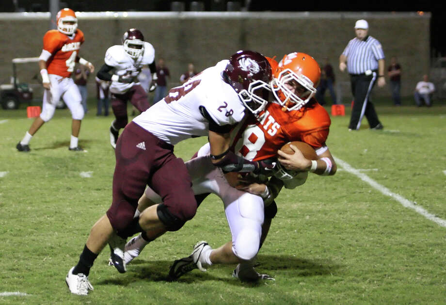 Orangefield quarterback Luke Johnson, No. 18, is tackled by Silsbee's Karl Elers during the game Friday at F.L. McClain Stadium in Orange. Matt Billiot/Special to The Enterprise Photo: Matt Billiot