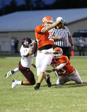 Orangefield punterMason Sonnier, 42, is tackled by Adam Valenvia of Silsbee after a mishandled snap during the game Friday at F.L. McClain Stadium in Orange. Matt Billiot/Special to The Enterprise Photo: Matt Billiot
