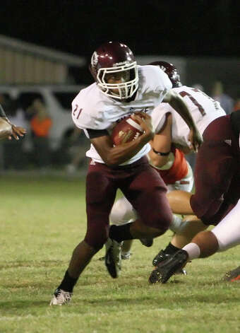 Silsbee running back Yancy Brydson, No. 21, rushes during the game against Orangefield Friday at F.L. McClain Stadium in Orange. Matt Billiot/Special to The Enterprise Photo: Matt Billiot