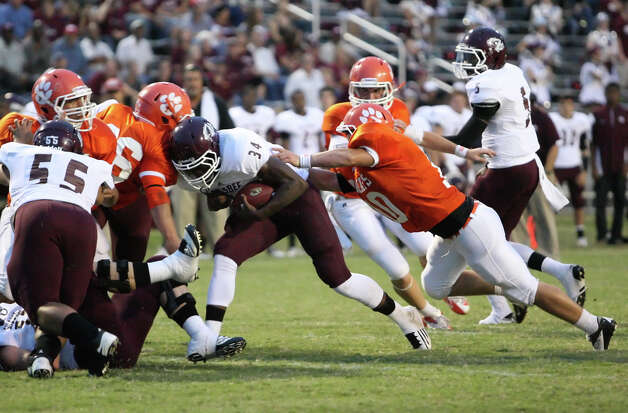 Silsbee running back Floyd Spearman, 34, is tackled Orangefield's Dustin Selman during the game Friday at F.L. McClain Stadium in Orange. Matt Billiot Photo: Matt Billiot