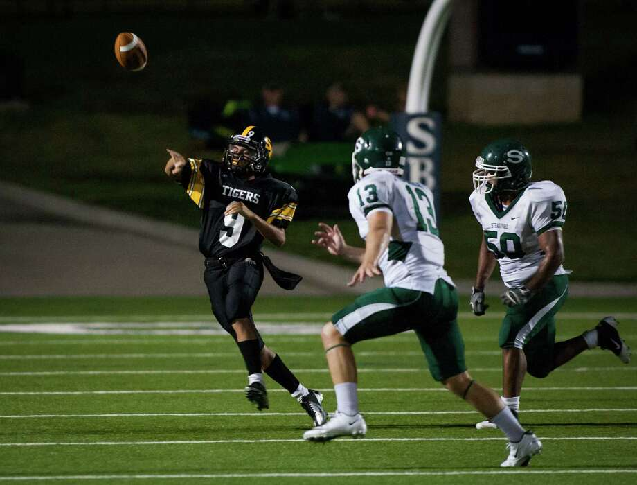 Spring Woods quarterback Xavier Giron (9) throws a pass during the second quarter of a high school football game at Darrell Tully Stadium on  Friday, Sept. 28, 2012, in Houston. Photo: Andrew Richardson, For The Chronicle / © 2012 Andrew Richardson