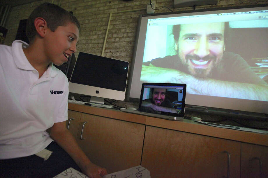 Fabian Suarez-Becker, a student at Whitby School in Greenwich, on video Skype with Ron ìBumblefootî Thal, a guitarist for Guns N' Roses. Photo: Contributed Photo