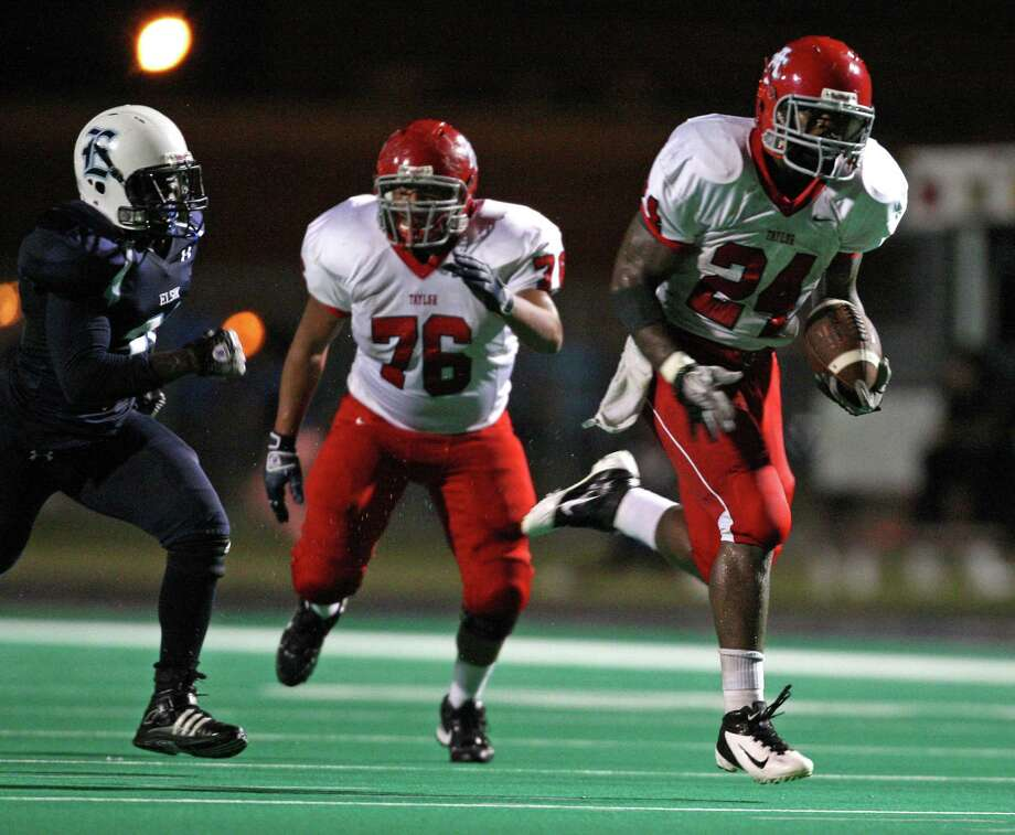 Alief Taylor running back Trevorris Johnson (24) runs past Elsik defensive lineman Clevon Reed for a 38-yard touchdown during the first half of a high school football game, Friday, September 28, 2012 at Crump Stadium in Houston, TX. Photo: Eric Christian Smith, For The Chronicle