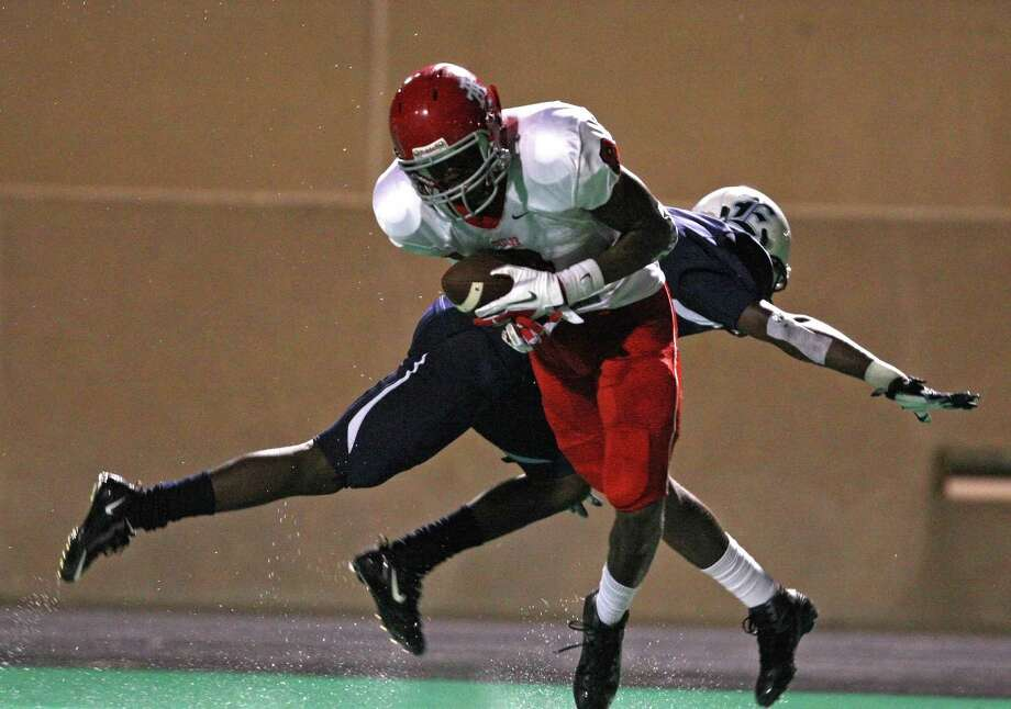 Alief Taylor wide receiver Keenen Brown (8) makes a reception past Elsik defensive back Dominique Barnett during the first half of a high school football game, Friday, September 28, 2012 at Crump Stadium in Houston, TX. Photo: Eric Christian Smith, For The Chronicle