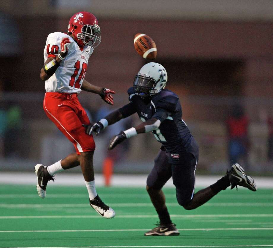During a punt, Alief Taylor's Josh Kalu (10) has the ball blocked away by Elsik's Greg Chuks during the first half of a high school football game, Friday, September 28, 2012 at Crump Stadium in Houston, TX. Photo: Eric Christian Smith, For The Chronicle