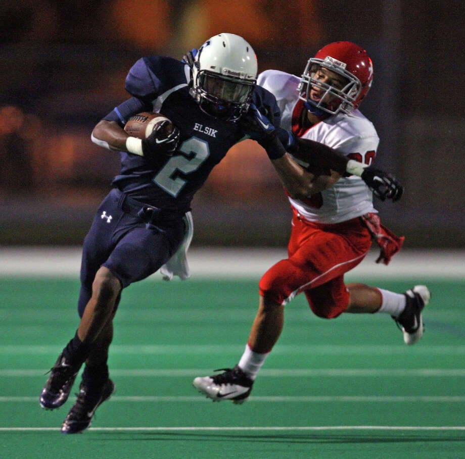 Elsik's Malcolm Washington (2) tries to fend off Alief Taylor's Tawnje Lusk during the first half of a high school football game, Friday, September 28, 2012 at Crump Stadium in Houston, TX. Photo: Eric Christian Smith, For The Chronicle