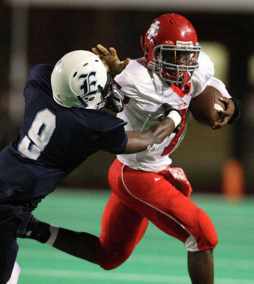 Alief Taylor quarterback Remi Olonade (7) fends off Elsik defensive back Dominique Barnett. Photo: Eric Christian Smith, For The Chronicle