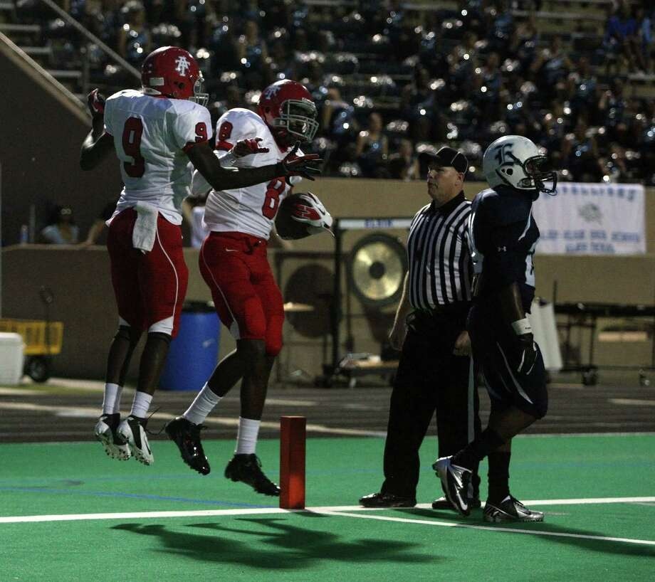 Alief Taylor wide receiver Keenen Brown celebrates his 23-yard touchdown reception with Godwin Ajisafe. Photo: Eric Christian Smith, For The Chronicle