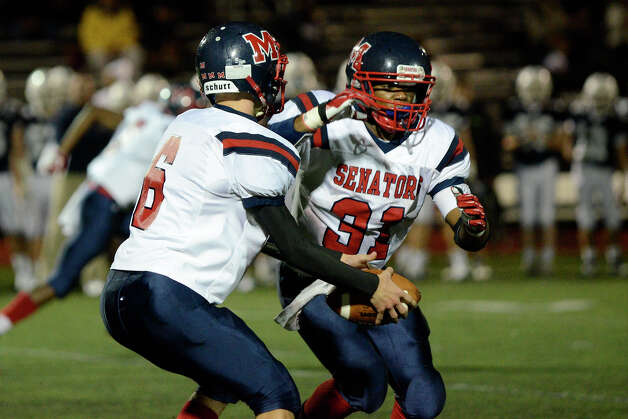McMahon #6 Matt Downey fakes the handoff to #31 Kyle Jordan as Staples High School hosts Brien McMahon High School in varsity football in Westport, CT on Sept. 28, 2012. Photo: Shelley Cryan / Shelley Cryan for the Stamford Advocate/ freelance Shelley Cryan
