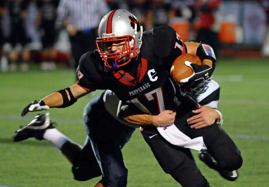 Pomperaug's #17 Carl Gatzendorfer gets tackled from behind by Weston's #3 Aaron Pomerance, during football action in Southbury, Conn. on Friday September 28, 2012. Photo: Christian Abraham / Connecticut Post