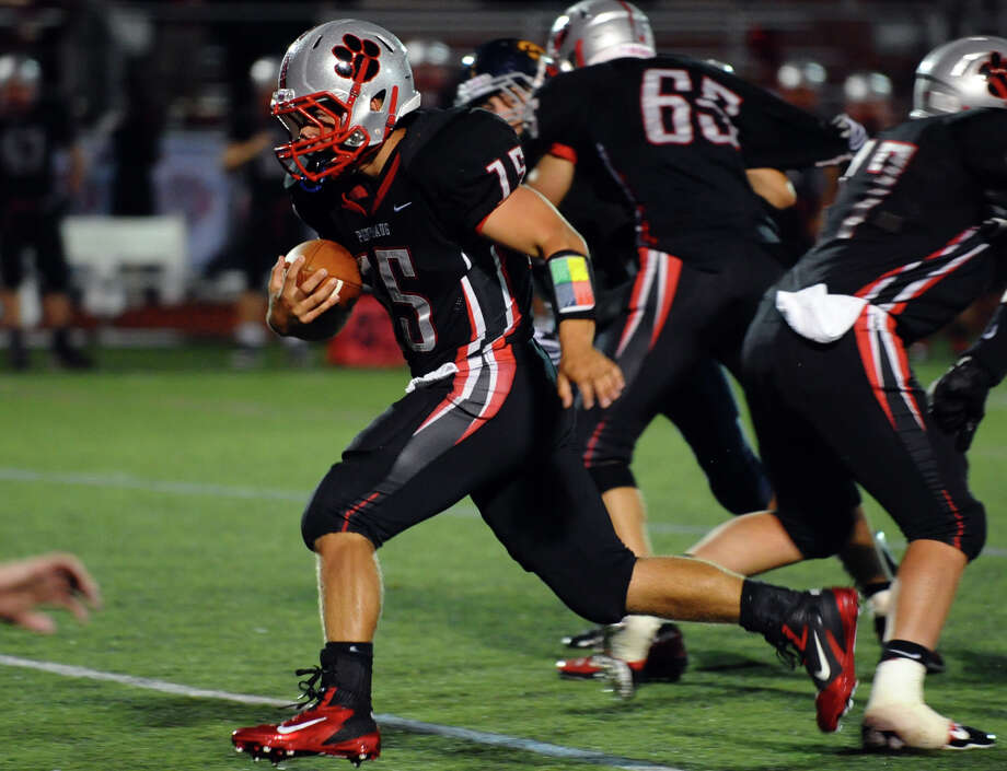 Pomperaug's #75 Adrian Zhuta gains some yardage, during football action against Weston in Southbury, Conn. on Friday September 28, 2012. Photo: Christian Abraham / Connecticut Post