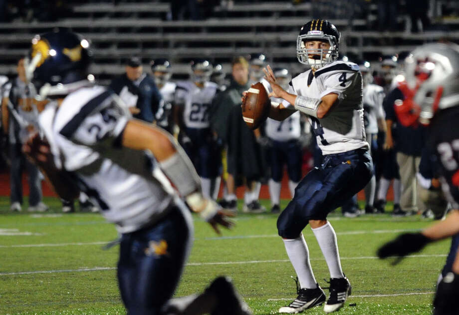 Weston's #4 Erik Dammen-Brower, during football action against Pomperaug in Southbury, Conn. on Friday September 28, 2012. Photo: Christian Abraham / Connecticut Post