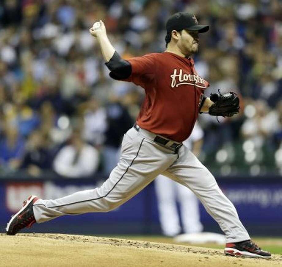 Sept. 28: Astros 7, Brewers 6Astros starting pitcher Edgar Gonzalez hurls a throw during the first inning. (Jeffrey Phelps / Associated Press)