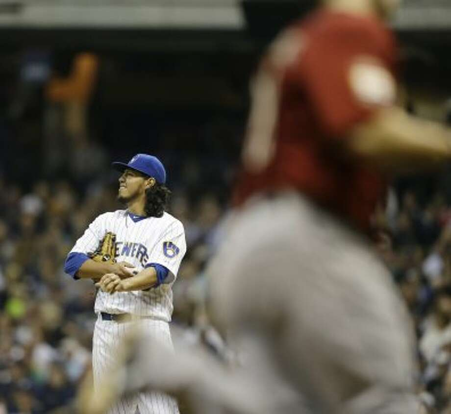 Brewers starting pitcher Yovani Gallardo looks away as Brett Wallace rounds the bases after his home run during the fifth inning. (Jeffrey Phelps / Associated Press)