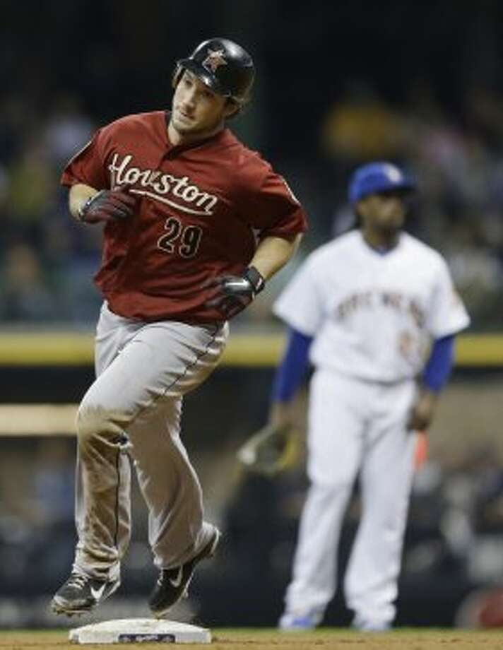 Brett Wallace rounds the bases after his home run in the fifth inning. (Jeffrey Phelps / Associated Press)