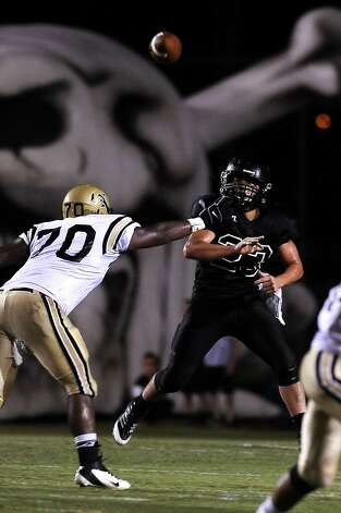 Vidor quarterback Montana Quirante makes a pass against Nederland at Vidor High School on Friday, September 29, 2012. Photo taken: Randy Edwards/The Enterprise Photo: Randy Edwards