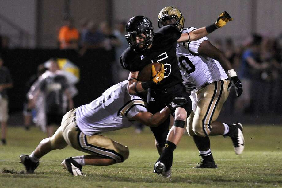 Vidor running back Thomas Novak makes a great run against Nederland at Vidor High School on Friday, September 29, 2012. Photo taken: Randy Edwards/The Enterprise Photo: Randy Edwards