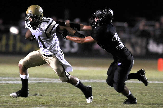 Nederland wide receiver Zach Taylor charges for a first down against Vidor at Vidor High School on Friday, September 29, 2012. Photo taken: Randy Edwards/The Enterprise Photo: Randy Edwards