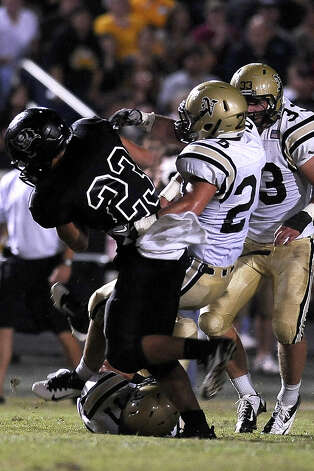 Vidor quarterback Montana Quirante on a quarterback keeper is tackled by Nederland linebacker Jordan Wood at Vidor High School on Friday, September 29, 2012. Photo taken: Randy Edwards/The Enterprise Photo: Randy Edwards