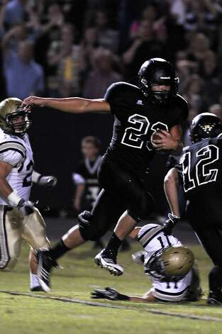 Vidor quarterback Montana Quirante with a quarterback keeper against Nederland at Vidor High School on Friday, September 29, 2012. Photo taken: Randy Edwards/The Enterprise