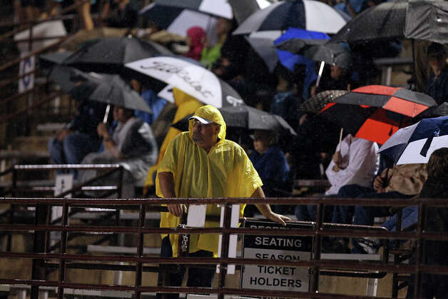 Rain doesn't stop faithful supporters as Champion hosts Alamo Heights at Boerne Stadium on September 28, 2012. Photo: Tom Reel, Express-News / ©2012 San Antono Express-News