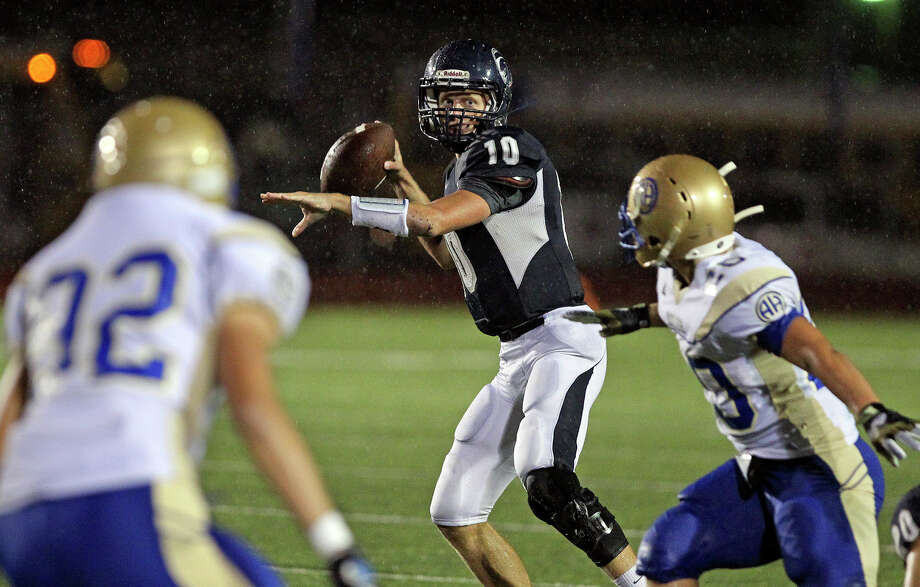 Kyle Poeske gets set to throw for the Chargers as Champion hosts Alamo Heights at Boerne Stadium on September 28, 2012. Photo: Tom Reel, Express-News / ©2012 San Antono Express-News