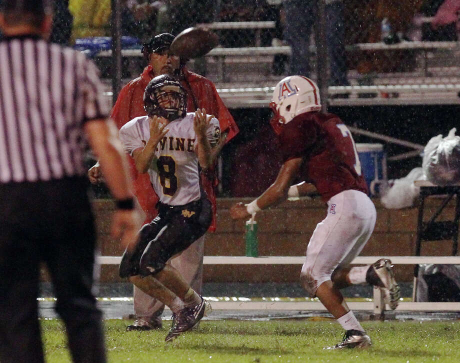 Devine's Cody Trivino (cq) (08) makes a catch on a fake punt play against Antonian's James Zertuche (07) during their game at Antonian High School on Friday, Sept. 28, 2012. Photo: Kin Man Hui, Express-News / ©2012 San Antonio Express-News