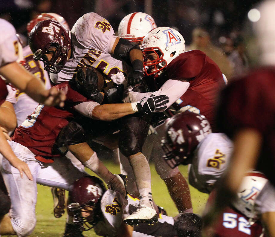 Devine's Jordan Fraga (center) gets triple-teamed by Antonian defenders during their game at Antonian High School on Friday, Sept. 28, 2012. Photo: Kin Man Hui, Express-News / ©2012 San Antonio Express-News