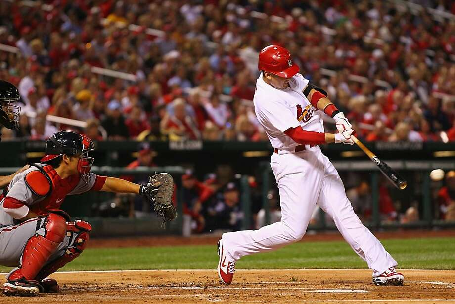 Allen Craig #21 of the St. Louis Cardinals hits an RBI single against the Washington Nationals at Busch Stadium. Photo: Dilip Vishwanat, Getty Images