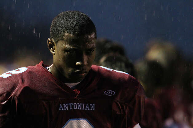 Antonian's Sterling Holmes (02) contends with rain during the playing of the National Anthem before the game against Devine at Antonian High School on Friday, Sept. 28, 2012. Photo: Kin Man Hui, Express-News / ©2012 San Antonio Express-News