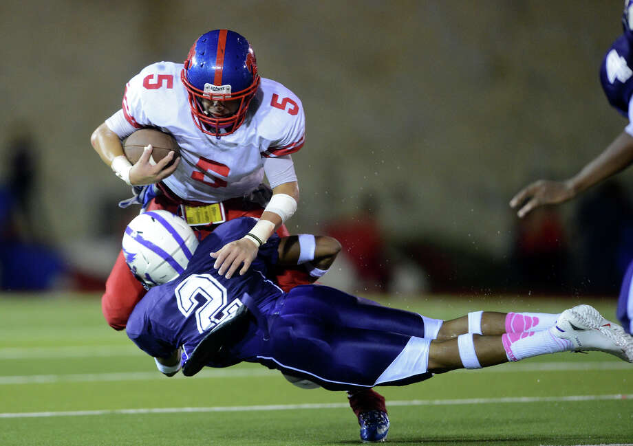 Jefferson's Mark Mangel (5) is tackled by Brackenridge's James Harris during a high school football game between Brackenridge and Jefferson at Alamo Stadium in San Antonio, Friday, September 28, 2012.