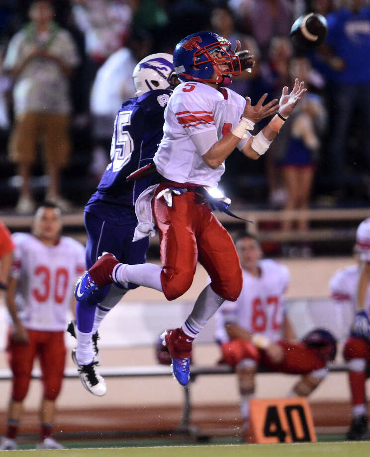 Jefferson's Mark Mangel (5) steps in front of Brackenridge's Kenneth May (85) to intercept a ball during a high school football game between Brackenridge and Jefferson at Alamo Stadium in San Antonio, Friday, September 28, 2012. John Albright / Special to the Express-News. Photo: JOHN ALBRIGHT, Express-News / San Antonio Express-News