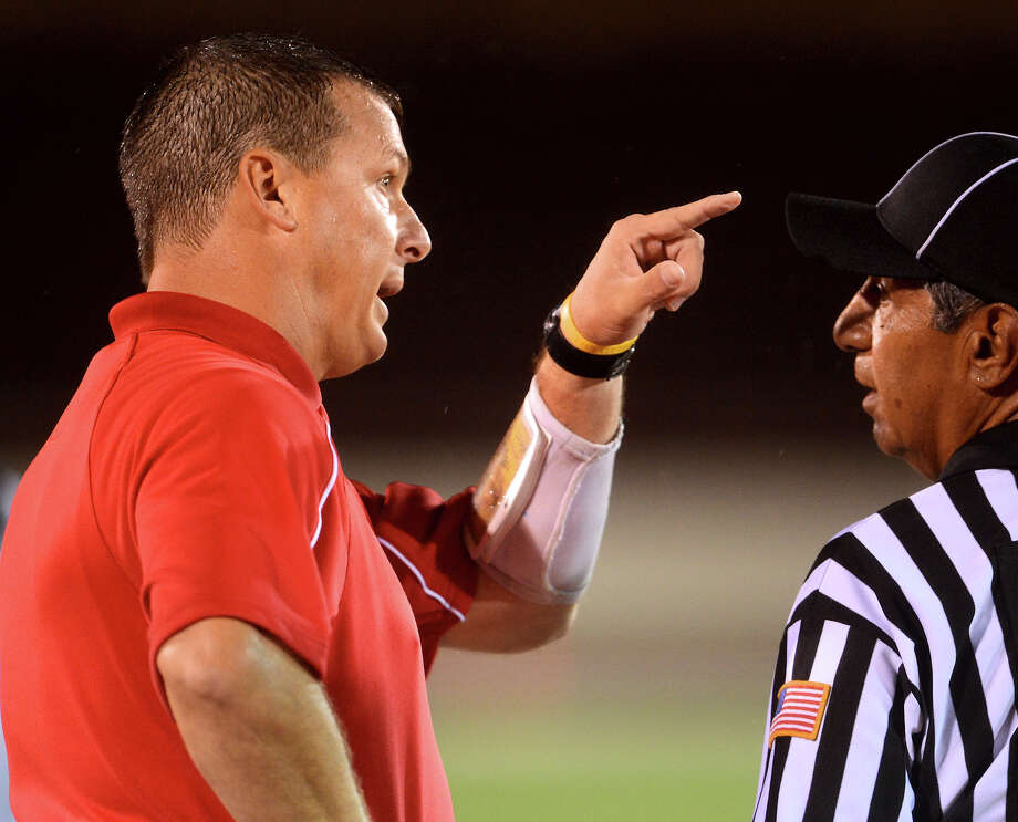 Jefferson head coach Doyle Redding talks to an official during a high school football game between Brackenridge and Jefferson at Alamo Stadium in San Antonio, Friday, September 28, 2012.