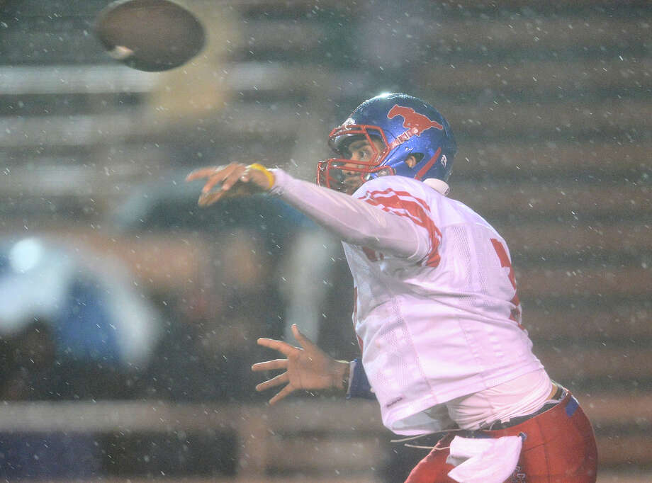 In a driving rain storm Jefferson's Jorge Flores throws a pass during a high school football game between Brackenridge and Jefferson at Alamo Stadium in San Antonio, Friday, September 28, 2012.